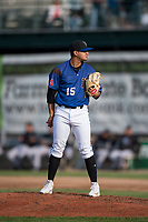 Missoula Osprey starting pitcher Edgar Martinez (15) looks in for the sign during a Pioneer League game against the Grand Junction Rockies at Ogren Park Allegiance Field on August 21, 2018 in Missoula, Montana. The Missoula Osprey defeated the Grand Junction Rockies by a score of 2-1. (Zachary Lucy/Four Seam Images)