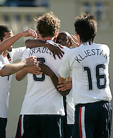 Michael Bradley (left) and Sacha Kljestan (right) celebrate with DaMarcus Beasley (middle). USA defeated China, 4-1, at Spartan Stadium in San Jose, Calif., on June 2, 2007.