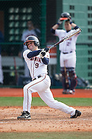 Kenny Towns (9) of the Virginia Cavaliers follows through on his swing against the Hartford Hawks at The Ripken Experience on February 27, 2015 in Myrtle Beach, South Carolina.  The Cavaliers defeated the Hawks 5-1.  (Brian Westerholt/Four Seam Images)