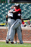 August 8, 2009:  Yordy Cabrera hugs Nick Castellanos after winning the home run derby during the Under Armour All-America event at Wrigley Field in Chicago, IL.  Photo By Mike Janes/Four Seam Images
