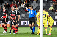 15th March 2021; Bankwest Stadium, Parramatta, New South Wales, Australia; A League Football, Western Sydney Wanderers versus Wellington Phoenix; Referee Shaun Evans gives Dylan McGowan of Western Sydney Wanderers a yellow card for the foul and the penalty kick awarded
