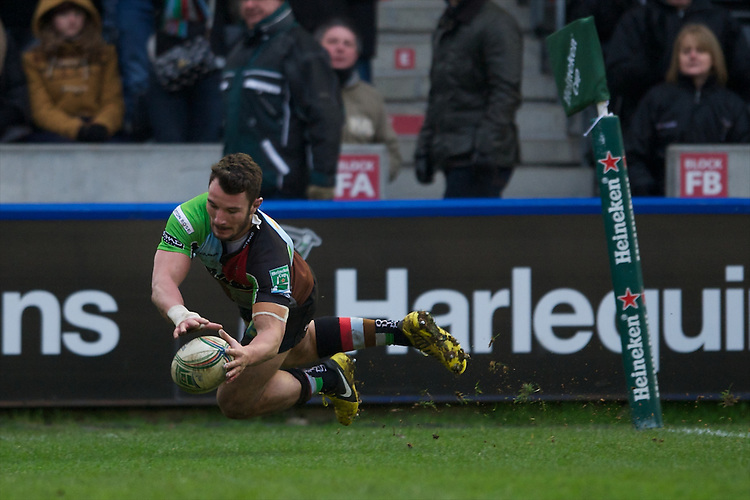 George Lowe of Harlequins dives over to score a try during the Heineken Cup match between Harlequins and Connacht Rugby at The Twickenham Stoop on Saturday 12th January 2013 (Photo by Rob Munro).