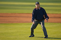 Umpire Jason Hutchings watches the flight of a foul ball at Fieldcrest Cannon Stadium April 11, 2009 in Kannapolis, North Carolina. (Photo by Brian Westerholt / Four Seam Images)