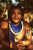 Altamira, Brazil. Bebdouri, chief of the Xicrin Kayapo village of Catete, with bead and shell necklaces and borduna club.