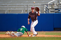 Union Dutchmen first baseman Jamie Faber (11) stretches for a throw as Brandon Ernest (6) dives back to the bag during a game against the Farmingdale Rams on March 21, 2016 at Chain of Lakes Stadium in Winter Haven, Florida.  Farmingdale defeated Union 17-5.  (Mike Janes/Four Seam Images)