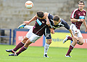 Rovers' player / manager Grant Murray grapples with Hearts' John Stuuton