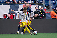 FOXBOROUGH, MA - MAY 16: Pedro Santos #7 Columbus SC crosses the ball towards the New England Revolution goal during a game between Columbus SC and New England Revolution at Gillette Stadium on May 16, 2021 in Foxborough, Massachusetts.
