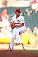 Richard Castillo (12) of the Springfield Cardinals winds up during a game against the Northwest Arkansas Naturals at Hammons Field on June 14, 2012 in Springfield, Missouri. (David Welker/Four Seam Images)