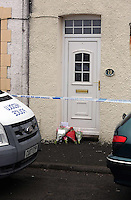 Pictured: Flowers and a cuddly toy left on the threshold of the family home in Pontyberem, Carmarthenshire, west Wales. Wednesday 19 February 2014 <br />