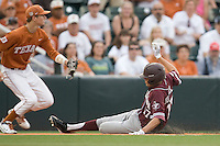 Texas A&M Aggies designated hitter Matt Juengel #17 slides into third before the throw against the Texas Longhorns in NCAA Big XII Conference baseball on May 21, 2011 at Disch Falk Field in Austin, Texas. (Photo by Andrew Woolley / Four Seam Images)