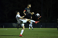 WINSTON-SALEM, NC - DECEMBER 07: Bruno Lapa #10 of Wake Forest University is defended by Mateo Restrepo Mejia #14 of the University of California Santa Barbara during a game between UC Santa Barbara and Wake Forest at W. Dennie Spry Stadium on December 07, 2019 in Winston-Salem, North Carolina.