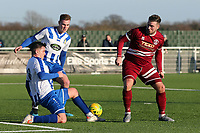 Sam Higgins of Chelmsford City and Jack Mochalski of Aveley during Aveley vs Chelmsford City, Buildbase FA Trophy Football at Parkside on 8th February 2020