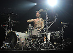 Travis Barker of Blink 182 checks his hand for a possible injury while they perform live in at The Hollywood Palladium in Hollywood, California on October 10,2009                                                                   Copyright 2009 DVS / RockinExposures