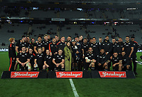 The All Blacks celebrate Aaron Smith's 100th game after the Bledisloe Cup rugby match between the New Zealand All Blacks and Australia Wallabies at Eden Park in Auckland, New Zealand on Saturday, 7 August 2021. Photo: Dave Lintott / lintottphoto.co.nz