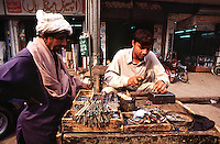 A boy is repairing keys at the Kashmiri Bazaar in the old town of Lahore.<br /> 15.2.2001, Lahore/Pakistan<br /> Copyright: Christian-Ditsch.de<br /> [Inhaltsveraendernde Manipulation des Fotos nur nach ausdruecklicher Genehmigung des Fotografen. Vereinbarungen ueber Abtretung von Persoenlichkeitsrechten/Model Release der abgebildeten Person/Personen liegen nicht vor. NO MODEL RELEASE! Nur fuer Redaktionelle Zwecke. Don't publish without copyright Christian-Ditsch.de, Veroeffentlichung nur mit Fotografennennung, sowie gegen Honorar, MwSt. und Beleg. Konto: I N G - D i B a, IBAN DE58500105175400192269, BIC INGDDEFFXXX, Kontakt: post@christian-ditsch.de<br /> Bei der Bearbeitung der Dateiinformationen darf die Urheberkennzeichnung in den EXIF- und  IPTC-Daten nicht entfernt werden, diese sind in digitalen Medien nach §95c UrhG rechtlich geschuetzt. Der Urhebervermerk wird gemaess §13 UrhG verlangt.]