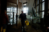 New York, New York.October 30, 2012..Workers clean up the lobby of the Financial Square office building that was flooded by Hurricane Sandy.