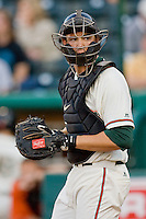 Catcher Kyle Skipworth #11 of the Greensboro Grasshoppers on defense against the Delmarva Shorebirds at NewBridge Bank Park April 15, 2010, in Greensboro, North Carolina.  Photo by Brian Westerholt / Four Seam Images