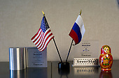 "Dearborn, Michigan<br /> USA<br /> February 16, 2011<br /> <br /> An American and Russian flag at the entrance to the office of Severstal North America CEO, Sergei Kuznetsov is about the only visual symbol of Russian ownership of the company in the entire plant.<br /> <br /> The former Ford Rouge Steel Plant completed in 1928 is now owned, run and being renovated and expanded by Russian owner ""Severstal North America"". This is one of five steel plants owned by Severstal in the United States and they are spending huge sums to convert it into what could be the continent's most efficient automotive steel plant.<br /> <br /> Rouge Steel fell on hard times after Ford Motor Company spun it off in 1989 into an independent steel company. <br /> <br /> After buying the assets of the bankrupt company for USD 280 million, Severstal spent USD 350 million to repair one of the blast furnaces. The company built a new cold-rolling line which converts steel slabs into sheet metal. And it added a galvanizing line which coats sheet metal with zinc for rust-resistant body panels.<br /> <br /> The operation assets and improvements amount to USD 1.4 billion. Add in spending on a new mini mill in Columbus, Mississippi a USD 1.6 billion operation and Severstal has placed a USD 3 billion bet on North America auto industry."