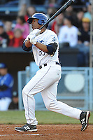 Asheville Tourists first baseman Harold Riggins #35 swings at a pitch during a game between the Delmarva Shorebirds and the Asheville Tourists at McCormick Field, Asheville, North Carolina April 6, 2012. The Shorebirds won the game 7-2  (Tony Farlow/Four Seam Images)..