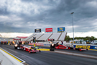 Jul 11, 2020; Clermont, Indiana, USA; NHRA top fuel driver Billy Torrence (left) races alongside son Steve Torrence during qualifying for the E3 Spark Plugs Nationals at Lucas Oil Raceway. This is the first race back for NHRA since the start of the COVID-19 global pandemic. Mandatory Credit: Mark J. Rebilas-USA TODAY Sports