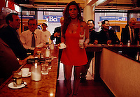 Coffee bars with sexy servers are on every block in downtown Santiago. Men stop in during the morning, coffee breaks, at noon, and all throughout the day to catch a cup of coffee and maybe a kiss from a scantily clad server. The waitress works for substantial tips at Cafe Cousino or Coffee with Legs. She can make $800 a week by flirting, lighting cigarettes and serving coffee.