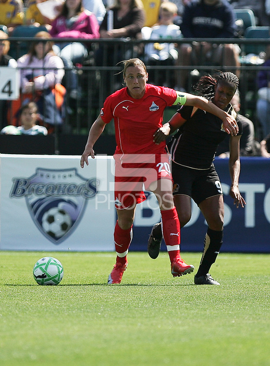 Abby Wambach (20) battles Kandace Wilson (9) for control of the ball. Washington Freedom defeated FC Gold Pride 4-3 at Buck Shaw Stadium in Santa Clara, California on April 26, 2009.