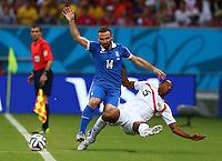 Dimitrios Salpingidis of Greece and Junior Diaz of Costa Rica in action