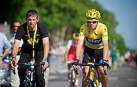 Chris Froome (GBR) chaperoned to the start by Team Sky press officer Dario Cioni<br /> <br /> Tour de France 2013<br /> (final) stage 21: Versailles - Paris Champs-Elysées<br /> 133,5km