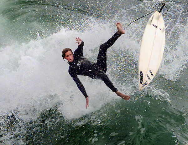 O.surf.0115.jl.photo lytle.14 year old Michael Wilkening of Oceanside, heads back down to earth after catching some high air in the large surf on the north side of the Oceanside Pier Thursday afternoon.