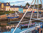 County Galway, Ireland: Morning light on harbor boats and village storefronts of the Connemara village of Roundstone