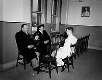 Un Freres blanc recoirt sa famille, quebec, janvier 1957<br /> PHOTO  : Agence Quebec Presse