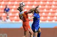 Houston, TX - Saturday May 27, 2017: Amber Brooks (12) of the Houston Dash heads the ball over Lindsay Elston  during a regular season National Women's Soccer League (NWSL) match between the Houston Dash and the Seattle Reign FC at BBVA Compass Stadium.