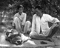 A refugee family from Ching Pung Men near Masan, now living in a refugee camp at Changseung-po, Korea.  October 1950. United Nations. (USIA)<br /> Exact Date Shot Unknown<br /> NARA FILE #:  306-PS-51-17008<br /> WAR & CONFLICT BOOK #:  1481