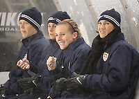 USA's players try to keep warm on the bench with hand warmers during a match against Mexico's at Rio Tinto Stadium March 31, 2010 in Salt Lake City, Utah. The USA women won the match over Mexico 1-0.