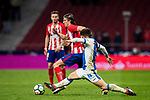 Filipe Luis (L) of Atletico de Madrid vies for the ball with Unai Bustinza, Bustinza M, of CD Leganes during the La Liga 2017-18 match between Atletico de Madrid and CD Leganes at Wanda Metropolitano on February 28 2018 in Madrid, Spain. Photo by Diego Souto / Power Sport Images