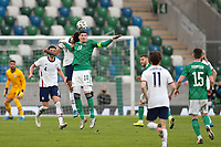 BELFAST, NORTHERN IRELAND - MARCH 28: Kyle Lafferty #10 of Northern Ireland goes up for a header with Chris Richards #15 of the United States during a game between Northern Ireland and USMNT at Windsor Park on March 28, 2021 in Belfast, Northern Ireland.