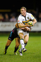 Chris Ashton of Northampton Saints is tackled during the LV= Cup second round match between Ospreys and Northampton Saints at Riverside Hardware Brewery Field, Bridgend (Photo by Rob Munro)