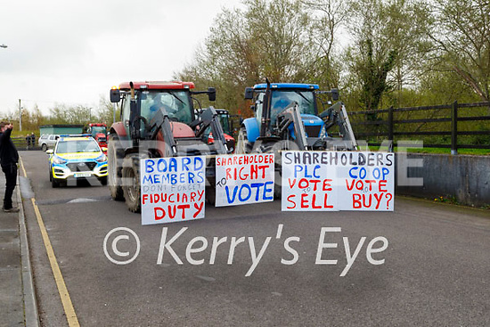 A Garda visit a group of Kerry farmers protest at the Kerry Co-Op offices in Fells Point  on Thursday.