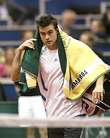 24-2-06, Netherlands, tennis, Rotterdam, ABNAMROWTT, Daniele Bracciali leaves the court after loosing to Nikolay Davydenko