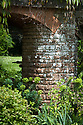 Columns of Bargate stone support the early 20th-century Pergola, Vann House and Garden, Surrey, mid June.