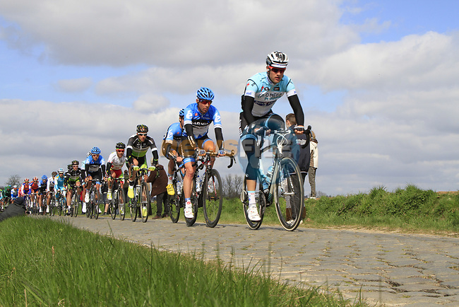 The peloton led by Omega Pharma-Quickstep and Garmin-Barracuda cross the 2nd cobbled sector at Doorne during the 96th edition of The Tour of Flanders 2012, running 256.9km from Bruges to Oudenaarde, Belgium. 1st April 2012. <br /> (Photo by Steven Franzoni/NEWSFILE).