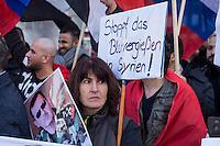 """250 bis 300 Menschen demonstrierten am Samstag den 31. Oktober 2015 in Berlin fuer die Unterstuetzung des syrischen Diktators Assad durch Russland. Sie trugen Fahnen Syriens, der ehemaligen Sowietunion, Russlands, Nordkoreas, der DDR, des Iran und Venezuelas, die sich """"alle zusammen gegen den Imperialismus zur Wehr setzen"""" wuerden. Russlands Praesident Putin wurde ausdruecklich fuer sein Militaerengagement gedankt, das Eingreifen der USA verurteilt.<br /> Im Bild: Eine Demonstrantin traegt ein Foto des syrischen Diktators. <br /> 31.10.2015, Berlin<br /> Copyright: Christian-Ditsch.de<br /> [Inhaltsveraendernde Manipulation des Fotos nur nach ausdruecklicher Genehmigung des Fotografen. Vereinbarungen ueber Abtretung von Persoenlichkeitsrechten/Model Release der abgebildeten Person/Personen liegen nicht vor. NO MODEL RELEASE! Nur fuer Redaktionelle Zwecke. Don't publish without copyright Christian-Ditsch.de, Veroeffentlichung nur mit Fotografennennung, sowie gegen Honorar, MwSt. und Beleg. Konto: I N G - D i B a, IBAN DE58500105175400192269, BIC INGDDEFFXXX, Kontakt: post@christian-ditsch.de<br /> Bei der Bearbeitung der Dateiinformationen darf die Urheberkennzeichnung in den EXIF- und  IPTC-Daten nicht entfernt werden, diese sind in digitalen Medien nach §95c UrhG rechtlich geschuetzt. Der Urhebervermerk wird gemaess §13 UrhG verlangt.]"""