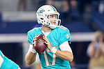 Miami Dolphins quarterback Ryan Tannehill (17) in action during the pre-season game between the Miami Dolphins and the Dallas Cowboys at the AT & T stadium in Arlington, Texas.