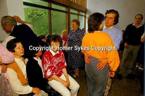 Lisdoonvarna County Clare Eire. 1990s. The annual month long matchmaking festival. Men and women dancing together, while desperate girls, young women sit three to a chair at the Spa Well Hotel morning dance.