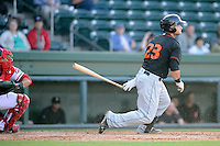 First baseman Christian Walker (23) of the Delmarva Shorebirds bats in a game against the Greenville Drive on Monday, April 29, 2013, at Fluor Field at the West End in Greenville, South Carolina. Walker played for the National Champion University of South Carolina Gamecocks. He is listed as the No. 12 prospect of the Baltimore Orioles, according to Baseball America. He was a fourth-round draft pick in 2012. Delmarva won, 6-5. (Tom Priddy/Four Seam Images)