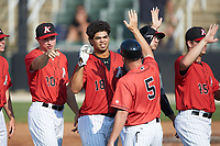 Amado Nunez (18) of the Kannapolis Intimidators high fives manager Ryan Newman (5) after hitting a walk-off home run in the bottom of the ninth inning against the Hickory Crawdads at Kannapolis Intimidators Stadium on June 2, 2019 in Kannapolis, North Carolina. The Intimidators defeated the Crawdads 4-3. (Brian Westerholt/Four Seam Images)