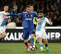 Calcio, Serie A: Napoli, stadio San Paolo, 2 aprile, 2017.<br /> Napoli's Lorenzo Insigne (r) in action with Claudio Marchisio (l) during the Italian Serie A football match between Napoli and Juventus at San Paolo stadium, April 2, 2017<br /> UPDATE IMAGES PRESS/Isabella Bonotto