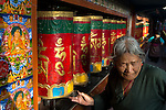 24 MAY 2015, McLeod Ganj, Himachal Pradesh, INDIA:  A Buddhist woman turns prayer wheels at a Buddhist temple in McLeod Ganj - the Indian home of the exiled Tibetan leader the Dalai Lama.   Picture by Graham Crouch/The Australian Magazine