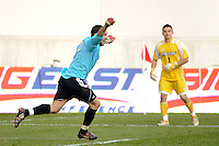 Louisville Cardinals goalkeeper Andre Boudreaux (30) celebrates making the game winning save during penalty kicks. The Louisville Cardinals defeated the Providence Friars 3-2 in penalty kicks after playing to a 1-1 tie during the finals of the Big East Men's Soccer Championship at Red Bull Arena in Harrison, NJ, on November 14, 2010.