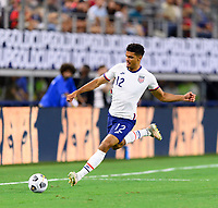 DALLAS, TX - JULY 25: Miles Robinson #12 of the United States takes a shot at the Jamaica goal during a game between Jamaica and USMNT at AT&T Stadium on July 25, 2021 in Dallas, Texas.
